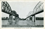 Postcard shows both the railroad bridge and the automobile bridge. Pub. by Koltermans 5c - $1.00 Store, Blair, Neb. No date given. Postcard unused.